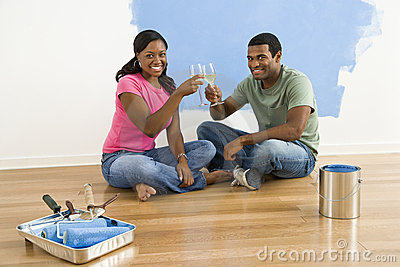 Couple toasting with wine.