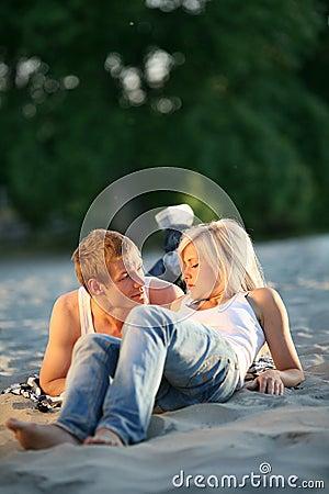 Couple together on sand beach