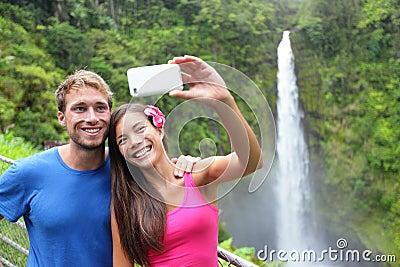 Couple tourists taking self portrait on Hawaii