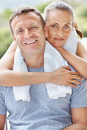 Couple with towel around neck after a workout