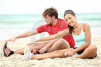 Couple training on beach