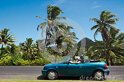 Couple travel by car in Tropical Island