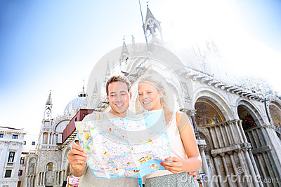 Couple on travel reading map on in Venice, Italy