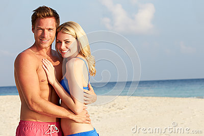 Couple On Tropical Beach Holiday