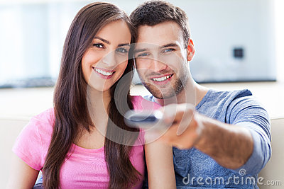 Couple with TV remote