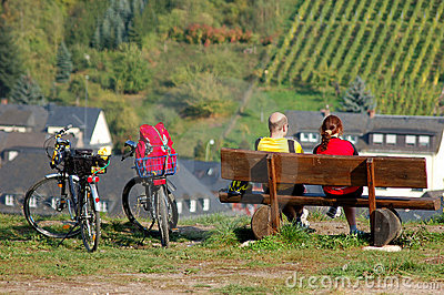 A Couple with two bicycles enjoing the landscape