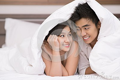 Couple under blanket