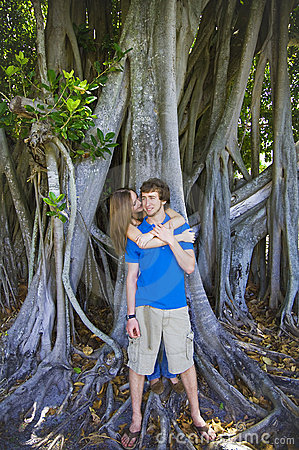 Couple under old tree