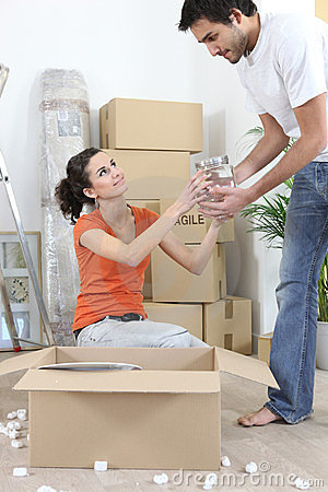 Couple unpacking belongings