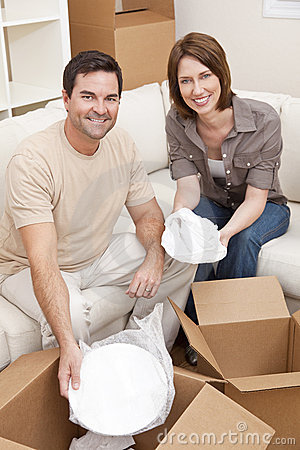 Couple Unpacking or Packing Boxes Moving House