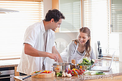 Couple using the internet to look up recipe