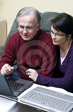 Couple using laptops