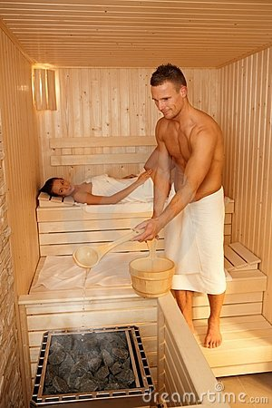 Couple using sauna