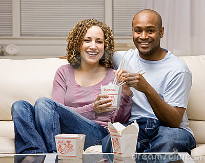 Couple using sharing chinese take-out