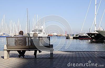 couple viewing boats at harbor