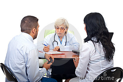 Couple visiting doctor in office