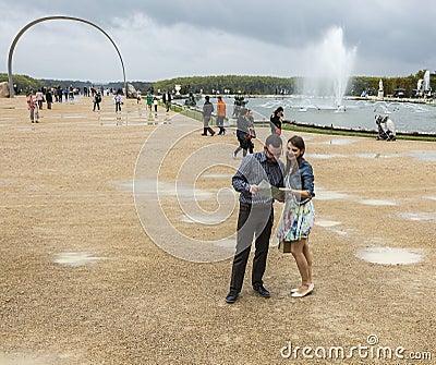 Couple Visiting a French Garden Editorial Stock Photo