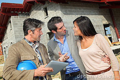 Couple visiting house under contruction