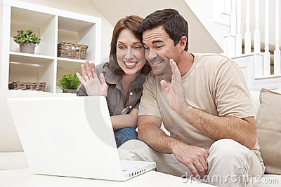 Couple VOIP Internet Phone Call on Laptop Computer
