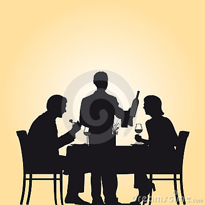 Couple and waiter in restaurant
