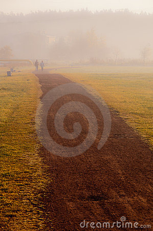 Couple walk in the mist