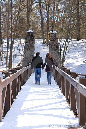 Free Couple Walking Across A Bridge Holding Hands Stock Images - 1925174
