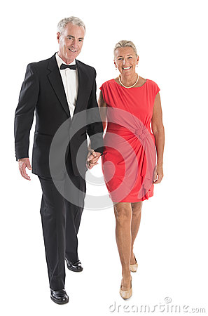 Couple Walking Against White Background
