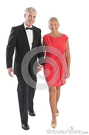 Couple Walking Against White Background