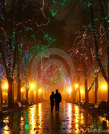 Couple walking at alley in night lights