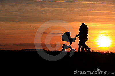 Couple walking baby car sunset