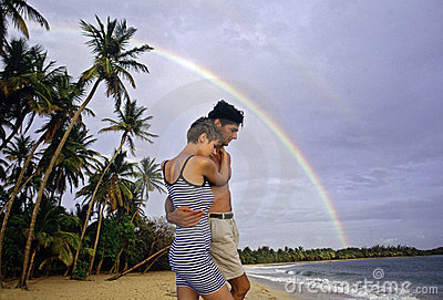 Couple Walking on Beach in Martinique Rainbow