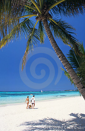 Couple walking on beach, Mauritius Island