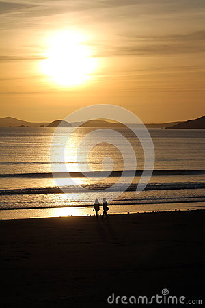 Couple Walking Beach with Sunset