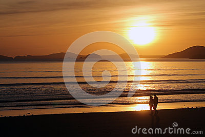 Couple Walking Beach at Sunset