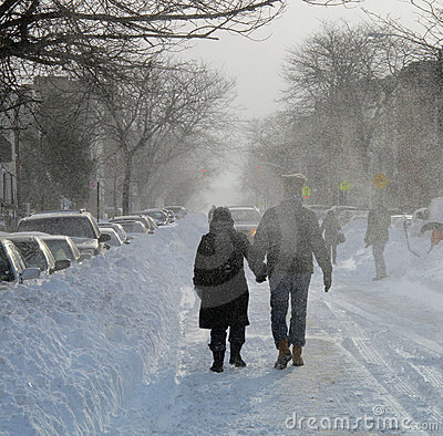 Couple walking through Blowing Snow Blizzard 2010 Editorial Stock Image