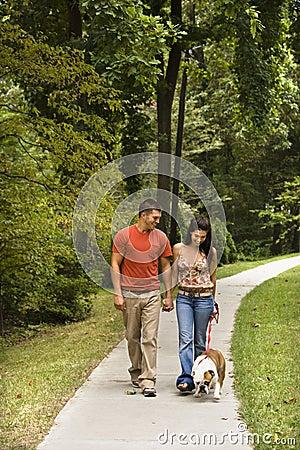 Couple walking dog.