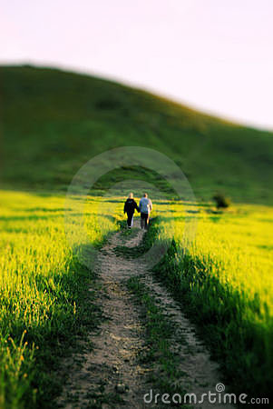 Couple Walking Down a Country Road