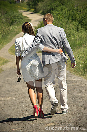 Couple walking down lane