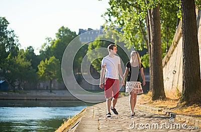 Couple walking near the Seine