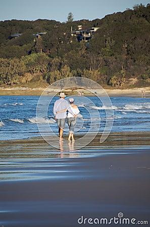 Free Couple Walking On Beach Stock Photo - 16646620