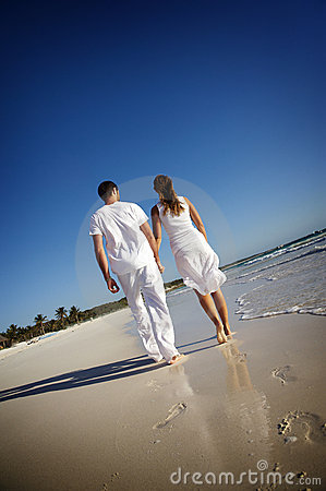 Free Couple Walking On Beach Stock Photo - 8127630