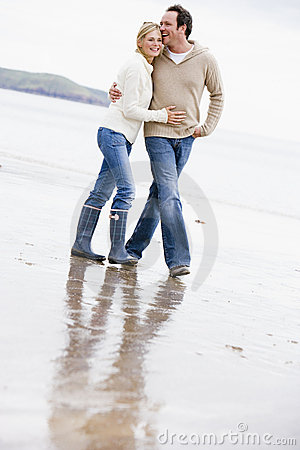 Free Couple Walking On Beach Arm In Arm Smiling Royalty Free Stock Photo - 5937625