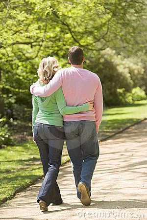 Free Couple Walking On Path Arm In Arm Stock Images - 5935764