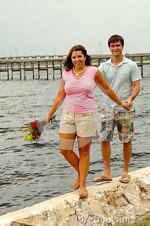 Free Couple Walking On Sea Wall Royalty Free Stock Photo - 6293975