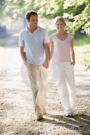 Free Couple Walking Outdoors Holding Hands And Smiling Stock Photo - 5931440