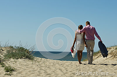 Couple walking on sand dunes
