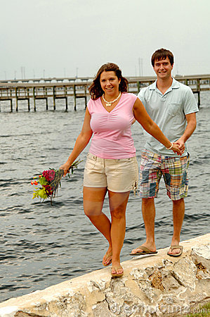 Couple walking on sea wall