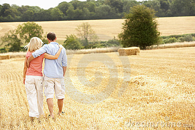 Couple Walking Together Through Summer Harvested F