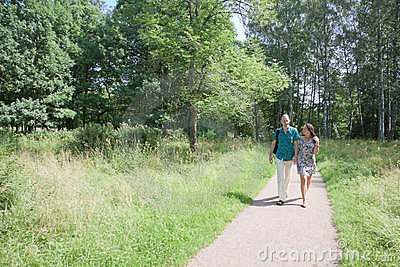 Couple walks in the park