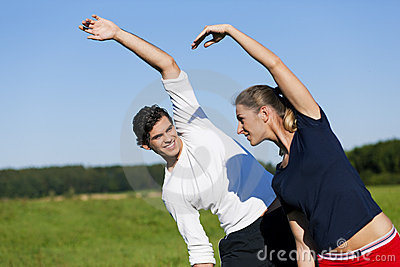 Couple warming up for exercise in summer